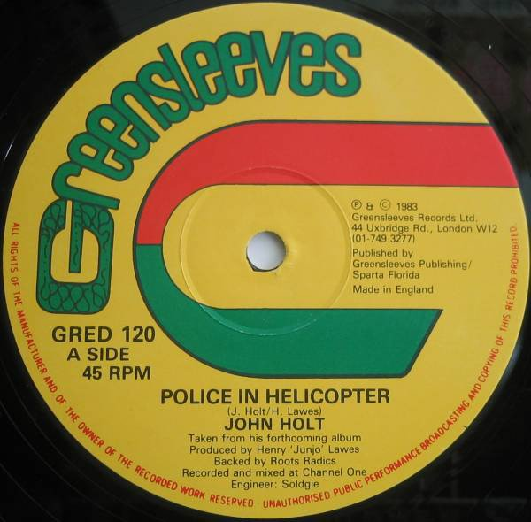 John Holt - Police In Helicopter / Youths Pon The Corner